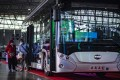 Visitors looking at a new energy bus during a promotional activity for new energy vehicles in Beijing. Photo: Xinhua