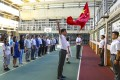 A flag-raising ceremony at Pui Kiu Middle School in North Point. Photo: Nora Tam