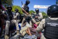 Police move detained demonstrators in the bed of a pick-up truck to a police station in Port-au-Prince, Haiti. Photo: AP