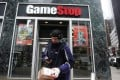 A FedEx delivery man prepares a package for a GameStop store in New York City on January 27. The video game retailer saw its stock price soar in the last week of January, backed by fans pitting themselves against large investors who had bet that the stock would fall. Photo: Reuters