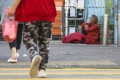 An elderly woman rests on the pavement in Sham Shui Po in January 2020. Photo: Nora Tam