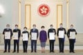 Chief Executive Carrie Lam hands awards to seven serving and retired police leaders in recognition of their public service. Photo: SCMP