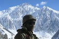 An Indian army soldier near Zojila mountain pass, which connects Srinagar to Ladakh. Photo: AFP