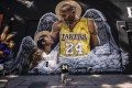 A fan pays respects to basketball legend Kobe Bryant and his daughter, Gianna, in front of a mural painted by artist Louie Sloe Palsino in Los Angeles in January. Photo: AP