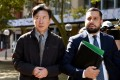 Chan Han Choi, left, leaves the King St Supreme Courts in Sydney earlier this month. He pleaded guilty on Wednesday to attempting to broker arms, oil and coal deals for Pyongyang. Photo: EPA