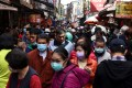 Crowds gather during the Lunar New Year holiday in Taiwan, where the coronavirus has been largely contained. Photo: Reuters