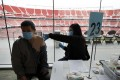 A man gets a Covid-19 vaccine shot at Levi's Stadium in Santa Clara, California. Photo: AFP