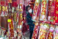 A woman shops for Lunar New Year decorations in Mong Kok. Photo: Edmond So