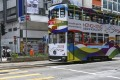 """Closed or struggling shops form the backdrop as a tram advertising Hong Kong as """"Asia's World City"""" stops at a red light in Causeway Bay, one of the city's major commercial districts. Photo: Nora Tam"""