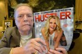 US porn mogul Larry Flynt poses with an issue of Hustler magazine at his office in California in August 2014. Photo: AFP