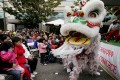 Lion dancers perform in Oakland's Chinatown. File photo: AP