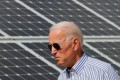 Joe Biden, then US presidential candidate, walks past solar panels while touring the Plymouth Area Renewable Energy Initiative in Plymouth, New Hampshire, on June 4, 2019. Photo: Reuters