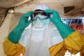 A medical worker puts on protective gear in an isolation ward of a hospital in Guinea, which is seeing the first resurgence of the Ebola haemorrhagic fever since a 2013-2016 epidemic left thousands dead. Photo: AFP