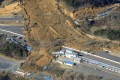 A landslide caused by a strong earthquake covers a circuit course in Nihonmatsu city, Fukushima prefecture, northeastern Japan. Photo: AP