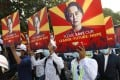Engineers hold posters with an image of deposed Myanmar leader Aung San Suu Kyi as they hold an anti-coup protest march. Photo: AP
