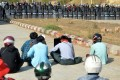 Riot police stand guard near a prison during a demonstration by protesters against the military coup in Naypyidaw on Monday. Photo: AFP