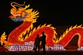 People talk in front of a giant dragon lantern in a park in Wuhan in China's central Hubei province on Thursday. Photo: AFP