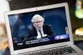 Warren Buffet, chairman and chief executive officer of Berkshire Hathaway Inc., speaks during the virtual Berkshire Hathaway annual shareholders meeting seen on a laptop computer in Arlington, Virginia, on Saturday, May 2, 2020. Photo: Bloomberg