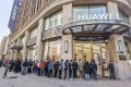 People wait in line in front of Huawei's flagship store for presales of the newly launched Huawei Mate40 mobile phone series in Shanghai, China, on October 23, 2020. Photo: AFP