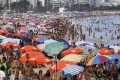 Beachgoers enjoy sunny weather in Rio de Janeiro. Brazil is battling a second infection wave. Photo: Reuters