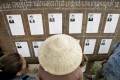 Laotians look at candidates' pictures at a polling station during the general election in 2006. Photo: Reuters