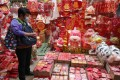 Lunar New Year decorations and lai see red packets are displayed for sale in Sham Shui Po on January 15. The HKMA should work with banks to facilitate the electronic transfer of lai see money. Photo: Edmond So