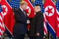 US President Donald Trump shakes hands with North Korea's leader Kim Jong-un before a meeting in Hanoi in 2019. Photo: AFP