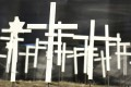 White crosses representing Covid-19 in California's Nevada County are seen at a memorial in Grass Valley in January. Photo: The Union via AP