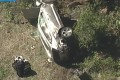 A vehicle rest on its side after a rollover accident involving golfer Tiger Woods in Los Angeles on Tuesday. Photo: KABC-TV via AP
