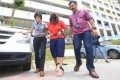 Gaiyathiri Murugayan (centre), is escorted from her Bishan flat in 2016 after the death of her 24-year-old Myanmar domestic helper Piang Ngaih Don. Photo: Today Online