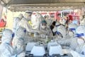 Medical workers process swab samples for Covid-19 tests in Selangor, Malaysia. Photo: Xinhua