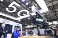 A large 5G signage is seen above an exhibition booth at telecommunications industry trade show MWC Shanghai on February 23, 2021. Photo: Xinhua