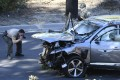 Police inspect the golfer Tiger Woods' damaged car after it was involved in a crash in California on Tuesday. Photo: DPA