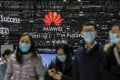 Attendees walk past the Huawei Technologies logo at the MWC Shanghai exhibition in Shanghai on Tuesday, Feb. 23, 2021. Photo: Bloomberg