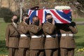 Soldiers from the Yorkshire Regiment carry the coffin of Captain Tom Moore during his funeral in Bedford on Saturday. Photo: AP