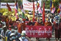 Buddhist monks holding banners and signs lead an anti-coup protest march in Mandalay, Myanmar, on Monday. Photo: AP