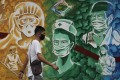 A mural outside the Mission Hospital in Pasig, Philippines, pays tribute to health workers. Photo: AP