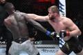 Jan Blachowicz punches Israel Adesanya in their UFC light heavyweight championship fight. Photos: Jeff Bottari/Zuffa LLC