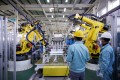 Robotics and new energy vehicles are among eight priority areas identified by Beijing to help advance the country's manufacturing capabilities. Photo: Reuters