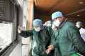 Members of the World Health Organization's coronavirus expert investigation group at a hospital in Wuhan during their visit earlier in the year. Photo: TPG