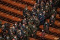 Military officers and other delegates leave after the second plenary session of the National People's Congress in Beijing on Monday. Photo: EPA-EFE