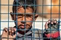 A boy awaits departure during the release of a group of Syrian families in Hasakeh governorate. The diversion of resources amid the Covid-19 pandemic would seem to bode poorly for an end to the misery for Syria's 23 million people. Photo: AFP