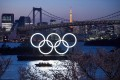 A boat sails past the Tokyo 2020 Olympic Rings in Tokyo. Photo: TNS
