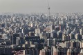 Despite draconian curbs on the demand side, property prices in China's main cities have surged over the past decade. Photo: AFP