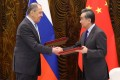 Russian Foreign Minister Sergey Lavrov (left) shakes hands with his Chinese counterpart Wang Yi in Guilin on Tuesday. Photo: Reuters