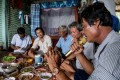 Shrimp farmers in the Mekong Delta enjoy a karaoke session during their group dinner. Photo: AFP