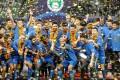 Jiangsu Suning players and staff members celebrate winning the Chinese Super League in November, 2020. Photo: AFP