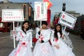 """Li Tingting, left, at the Bloody Brides protest in Beijing 2012. Two years later the freedom to carry out such protests appeared to have diminished when two of the """"brides"""" were arrested over another protest."""
