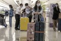 Travellers are seen at Singapore's Changi Airport. The city state is restricting arrivals from India and has extended its mandatory two-week quarantine period by another week. Photo: EPA-EFE