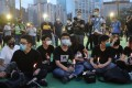 Joshua Wong (centre) last week admitted taking part in the unauthorised June 4 vigil. Photo: Sam Tsang